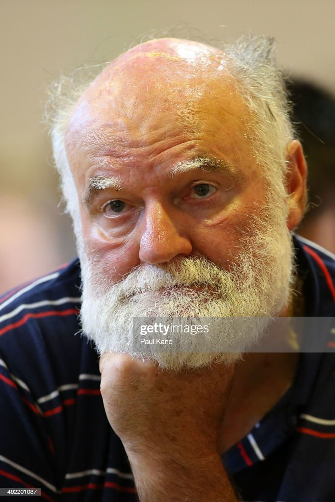 An elderly man looks on during a community meeting to advise residents of the current fire situation at the Brown Park community centre on January 13, 2014 in Perth, Australia. Evacuated residents of Perth Hills are awaiting permission to access and inspect their properties after a bushfire blazed through the suburb, destroying 46 homes. Emergency services are assessing the affected area and expected the number of properties damaged to increase.