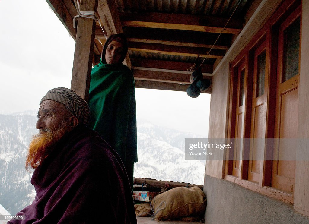 An elderly man looks towards Pakistan administered Kashmir from his residential house in Churunda village on January 12, 2013, northwest of Srinagar, the summer capital of Indian Administered Kashshmir, India. The village with a population of a little over 12,000 people has been bearing the brunt of cross-fire between nuclear rivals India and Pakistan. Last week a Pakistan solider was killed across the Line of Control (LOC), a military line that divides Indian-administered Kashmir from the Pakistan-administered Kashmir at this village. People living along the LoC have continually been at risk due to hostility between the armies of the two rival nations. Last year, in November, three people, including a pregnant woman, had died after a shell fired from Pakistan landed on one of the houses in the village. Tension between Pakistan and India has escalated after a fresh skimirish along the border. Both countries have summoned each other's envoy to protest against unacceptable and unprovoked' attacks.