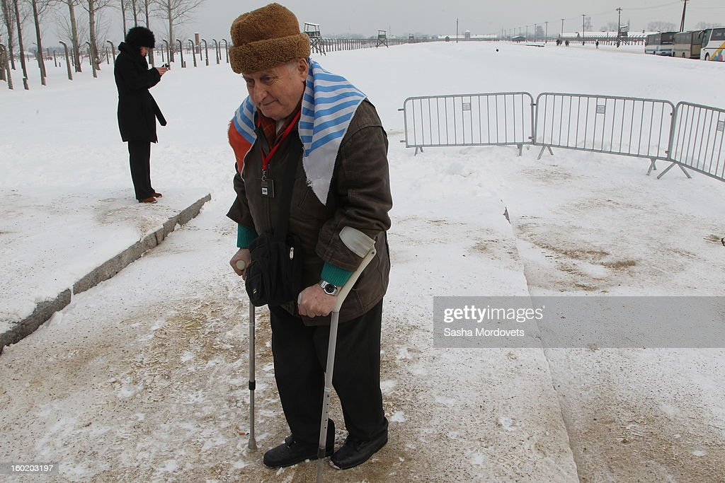 An elderly man passes the gates of the former Auschwitz Birkenau Nazi concentration camp January 27, 2013 near Oswiecim, Poland. A ceremony marked the 68th anniversary of the liberation of the camp during International Holocaust Remembrance Day.