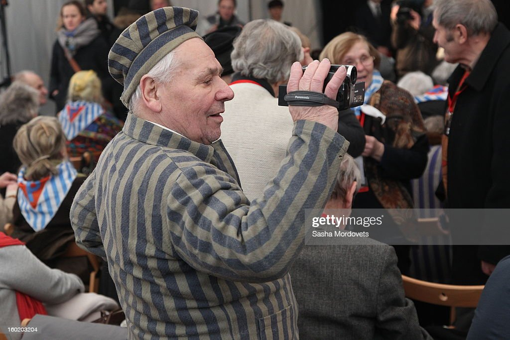 An elderly man shoots video at the former Auschwitz Birkenau Nazi concentration camp January 27, 2013 near Oswiecim, Poland. A ceremony marked the 68th anniversary of the liberation of the camp during International Holocaust Remembrance Day.