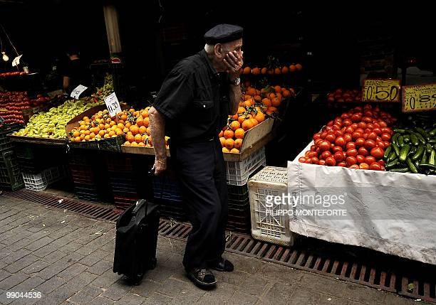 An elderly man shops in Athens central market on May 12 2010 Greece was to receive a first dose of 55 billion euros from the IMF under a massive...