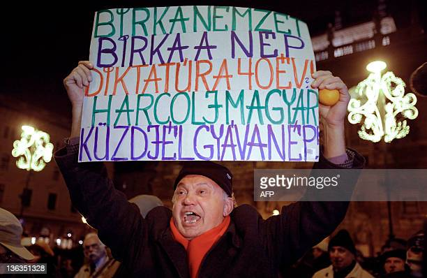 An elderly man shouts an antigovernemnt slogan at the State Opera House of Budapest as tens of thousands protest against Hungary's new constitution...