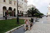 An elderly man sits and rests with his walking stick on Aristotelous square in Thessaloniki Greece on Friday July 3 2015 Greece is divided right down...