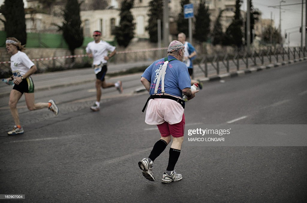 An elderly man takes part in Jerusalem's third annual marathon on March 1, 2013. About 20,000 runners took part in Jerusalem's third annual marathon, with 1,000 police deployed to provide security along the route, police said.