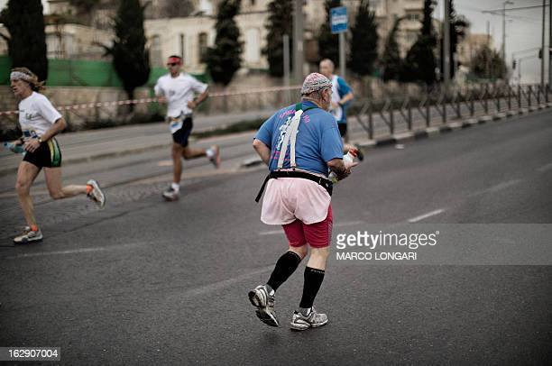 An elderly man takes part in Jerusalem's third annual marathon on March 1 2013 About 20000 runners took part in Jerusalem's third annual marathon...