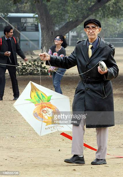 An elderly man trying his hand at kite flying during the Kite festival 2012 at India Gate on January 7 2012 in New Delhi India 300 kite fliers from...