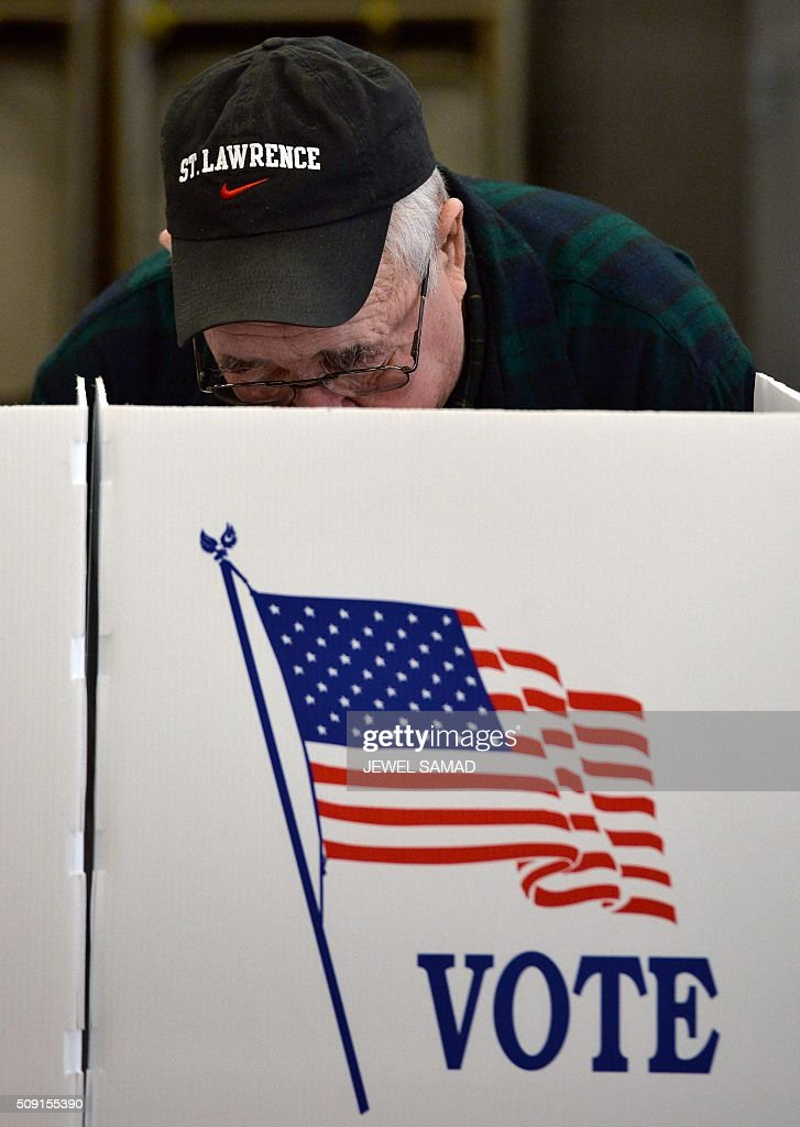 An elderly man votes for the first US presidential primary at a fire station in Loudon, New Hampshire, on February 9, 2016. New Hampshire began voting on February 9 in the first US presidential primary with Republican Donald Trump calling on supporters to propel him to victory and Democrat Bernie Sanders primed to upstage Hillary Clinton. The northeastern state, home to just 1.3 million people, sets the tone for the primaries and could shake out a crowded Republican field of candidates pitting Trump and arch-conservative Senator Ted Cruz against more establishment candidates led by Senator Marco Rubio. SAMAD