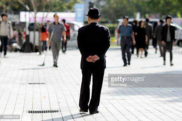 An elderly man walks down a street in the Jongrogu area of Seoul South Korea on Wednesday Oct 23 2013 President Park Geun Hye in her 2014 budget...