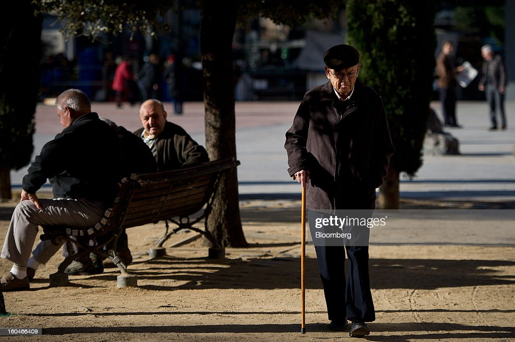 An elderly man walks through the city park in Figueres, Spain, on Thursday, Jan. 31, 2013. Spain's recession deepened more than economists forecast in the fourth quarter as the government's struggle to rein in the euro region's second-largest budget deficit weighed on domestic demand. Photographer: David Ramos/Bloomberg via Getty Images
