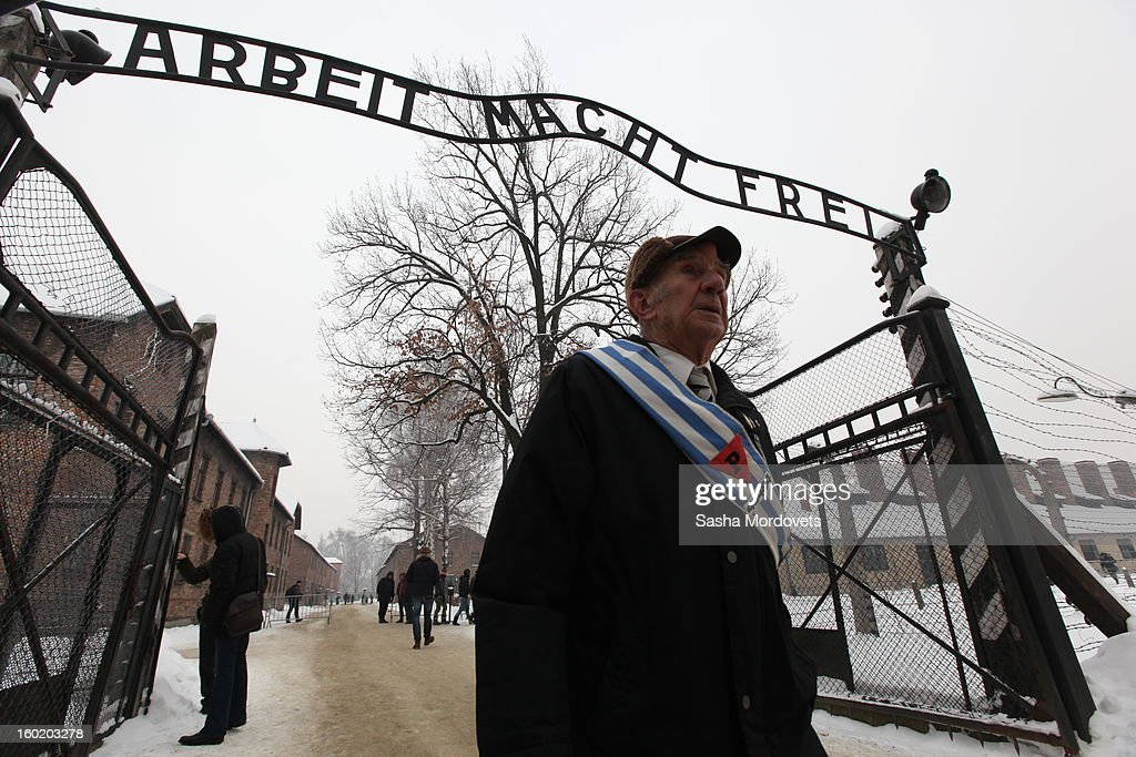 An elderly man walks through the gates at the former Auschwitz Birkenau Nazi concentration camp January 27, 2013 near Oswiecim, Poland. A ceremony marked the 68th anniversary of the liberation of the camp during International Holocaust Remembrance Day.