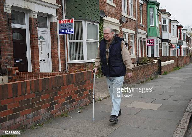 An elderly man walks up a street as voters head to the polls on May 2 2013 in South Shields England The byelection was triggered after the former...