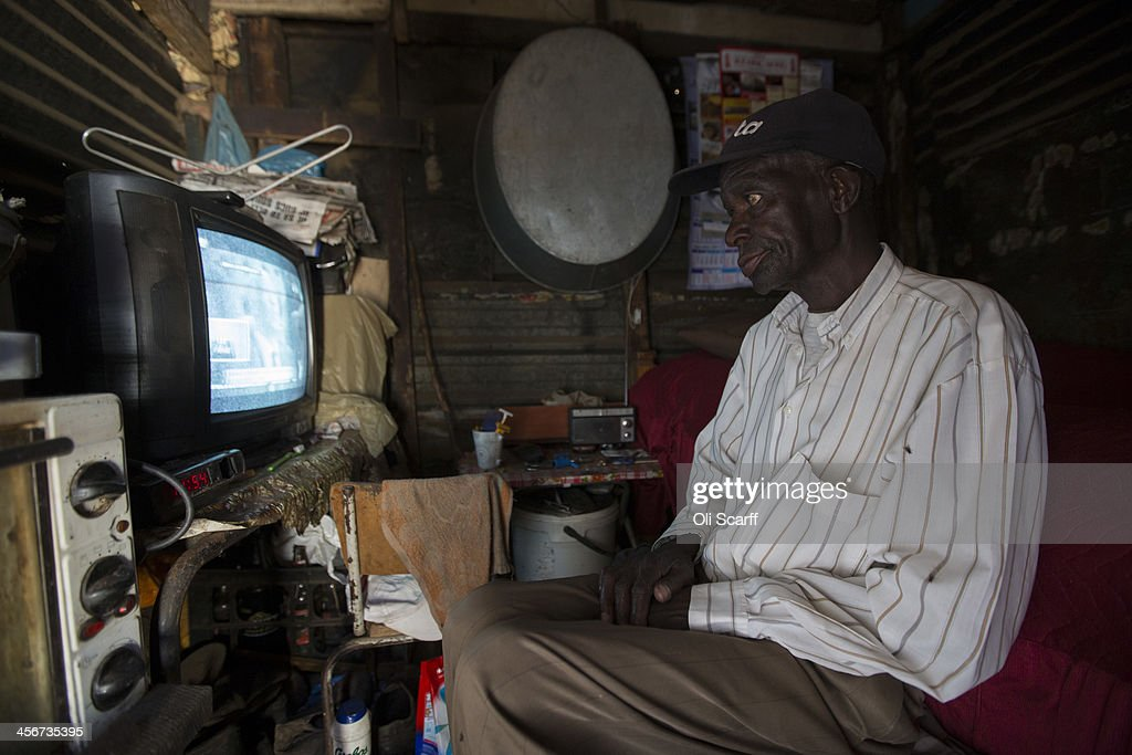 An elderly man watches the funeral of former South African President Nelson Mandela on television in his home in Soweto Township on December 15, 2013 in Soweto, South Africa. Mr Mandela passed away on the evening of December 5, 2013 at his home in Houghton at the age of 95. Mandela became South Africa's first black president in 1994 after spending 27 years in jail for his activism against apartheid in a racially-divided South Africa.