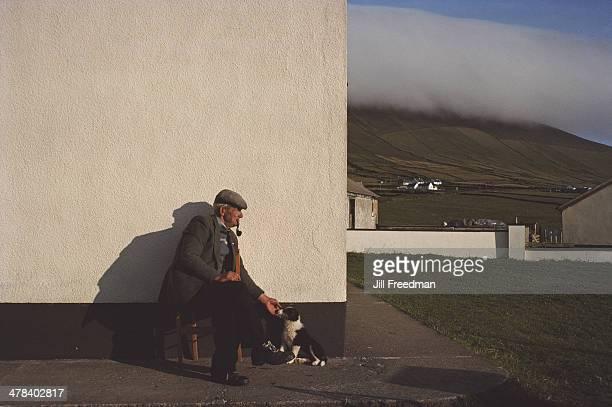 An elderly man with a puppy in Ireland 1988