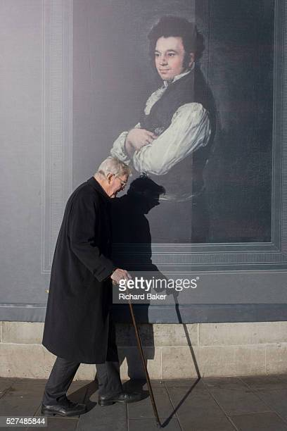 An elderly man with a stick walks past the portrait by Francesco Goya of Don Tiburcio P��rez y Cuervo the Architect sponsored by Credit Suisse and...