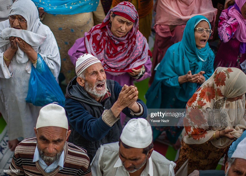 An elderly Muslim man pray as a head priest displays the holy relic believed to be the whisker from the beard of the Prophet Mohammed at the...