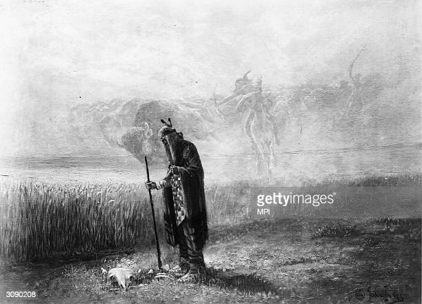 An elderly Native American gazes thoughtfully at the skull of a buffalo while in the sky above him the spirits of longdead hunters merge with...