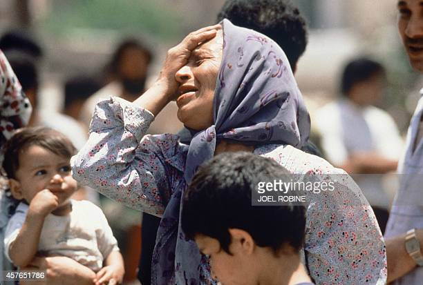 An elderly Palestinian woman mourns 27 May 1985 a member of her family killed in the fighting between Palestinian guerrillas and Amal Shi'ite militia...