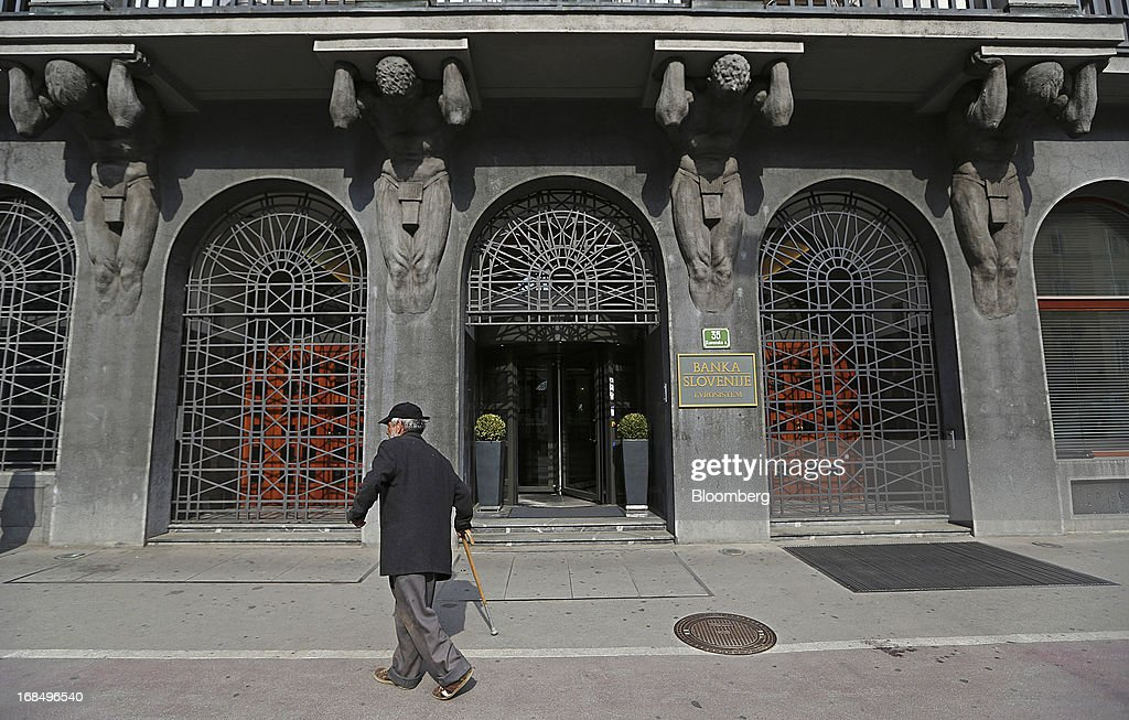An elderly pedestrian passes the entrance to the central bank, also known as Banka Slovenije, in Ljubljana, Slovenia, on Friday, May 10, 2013. The Adriatic nation is seeking to fix its ailing lenders with a cash injection of at least 900 million euros ($1.17 billion) after Cyprus's bailout focused investors on countries with weak banking industries. Photographer: Chris Ratcliffe/Bloomberg via Getty Images