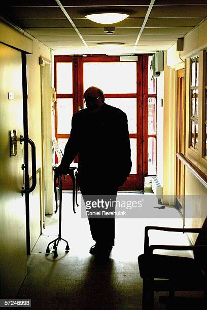 An elderly pensioner walks through a corridor aided by his walking stick on April 4 2006 in London England The State Pension Commission today...