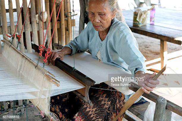 An elderly Phu Tai ethnic minority woman weaves handspun cotton Ban Lahanam Savannakhet province Lao PDR Cotton has been grown in Laos for centuries...