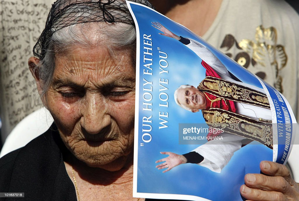 An elderly pilgrim attends a ceremony with Pope Benedict XVI at a Maronite elementary school in Nicosia on June 5, 2010 on the second day of the pontiff's visit to the mainly Greek Orthodox Mediterranean island.