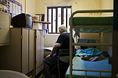 An elderly prisoner reading the newspaper in his cell HMP YOI Littlehey Littlehey is a purpose build category C prison