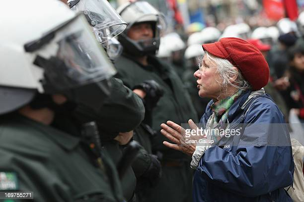 An elderly protester talks to riot police during the main Blockupy demonstration in the financial district on June 1 2013 in Frankfurt am Main...