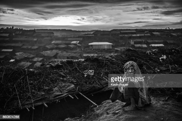 COX'S BAZAR BANGLADESH SEPTEMBER 22 An elderly Rohingya refugees woman sits outside her shelter in the sprawling Balukali refugee camp on September...