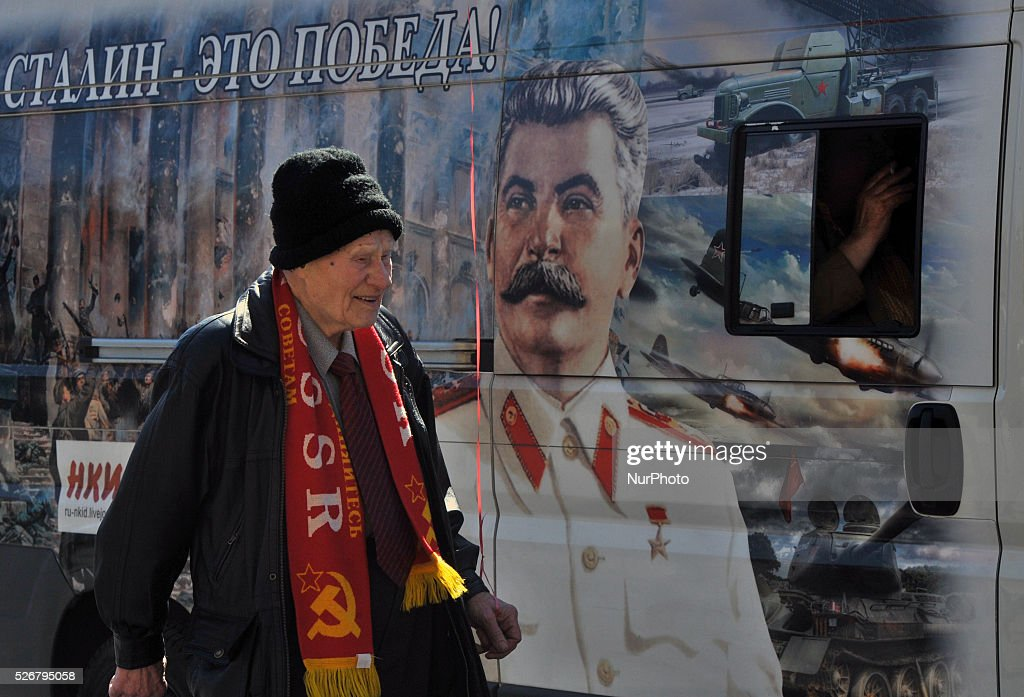 An elderly Russian man marches with a red balloon near a portrait of former Soviet dictator Josef Stalin during the May Day demonstration on Nevsky prospect in St. Petersburg, Russia, on May, 1, 2016. Labor Day or May Day is observed all over the world on the first day of the May to celebrate the economic and social achievements of workers and fight for laborers rights.