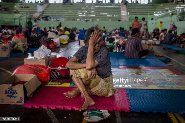 KLUNGKUNG BALI INDONESIA SEPTEMBER 27 An elderly sits in temporary shelter after being evacuated from their village at sport center on September 27...