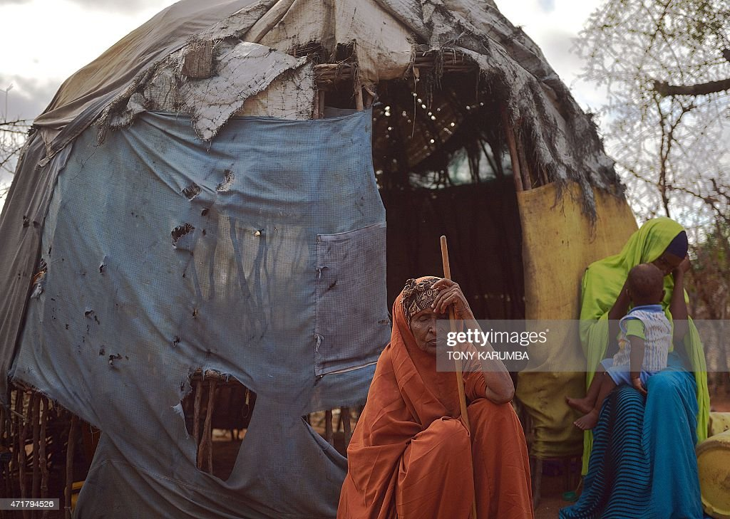 An elderly somali woman sits with her kin outside their kitchen at their compound at Hagadera sector of the Dadaab refugee camp north of the Kenyan...