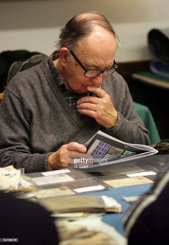 An elderly stamp collector looks through a book of stamps for sale at the Strand Stamp Show in the Royal National Hotel on January 7, 2008 in London, England. The monthly Strand Stamp Show held in London attracts philatelist dealers and collectors from around the country..