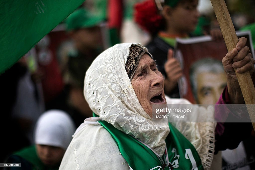 An elderly supporter of Hamas shouts slogans during a rally to mark the 25th anniversary of the founding of the Islamist movement, in Gaza on December 8, 2012. Tens of thousands of Palestinians massed in Gaza for a rally marking the anniversary to be addressed by Hamas leader in exile Khaled Meshaal, who is on his first ever visit to Gaza.