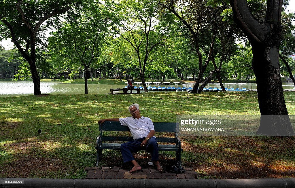 An elderly Thai man takes a nap inside the Lumpini Park in Bangkok on May 25, 2010 where Red Shirts protestors camped during their two month protest. Thai authorities will ask the government to extend a curfew in Bangkok and 23 provinces for another week in the wake of a crackdown on anti-government protesters, an army official said Monday.