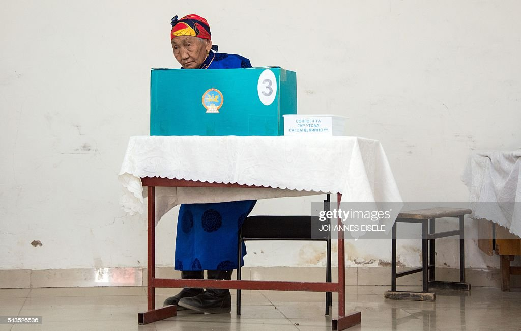 An elderly villager casts her vote in the parliamentary elections at a polling station in Mandalgovi in the middle of Gobi province on June 29, 2016. Mongolians went to the polls across their sprawling, sparsely-populated country on June 29 as it struggles to benefit from its vast natural resources amid disputes over foreign investment and slumping demand from neighbouring China. EISELE