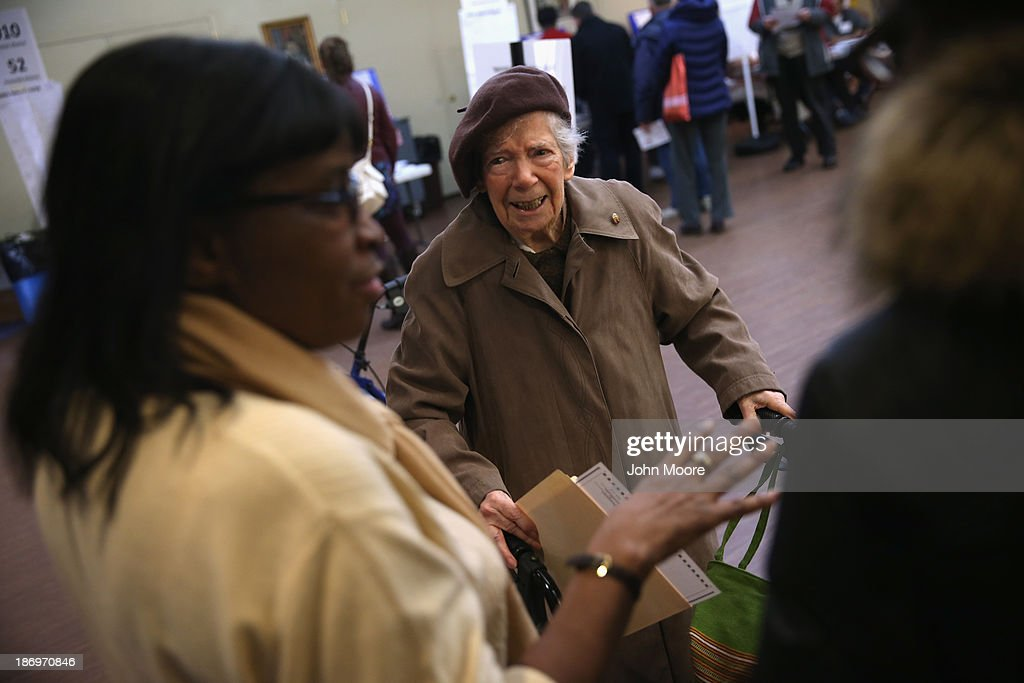 An elderly voter asks for assistance at a polling station on November 5, 2013 in the Brooklyn borough of New York City. New Yorkers went to the polls to choose between Democratic candidate Bill de Blasio and Republican Joe Lhota. De Blasio was widely considered the favorite going into election day.