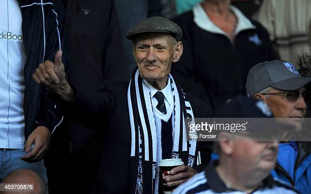 An elderly WBA fan looks on before the Barclays Premier League match between West Bromwich Albion and Sunderland at The Hawthorns on August 16 2014...