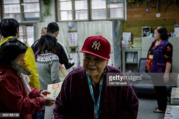 An elderly woman after voting at a polling station on January 16 2016 in Taipei Taiwan Voters in Taiwan are set to elect Tsai Ingwen the chairwoman...