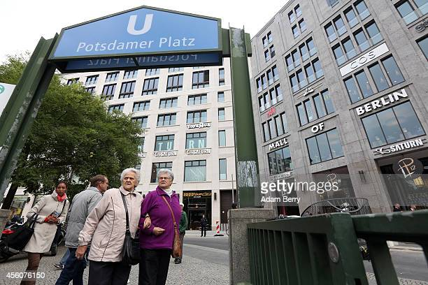 An elderly woman and her daughter discuss the changes that have occurred at Potsdamer Platz during the opening of the Mall of Berlin on September 25...