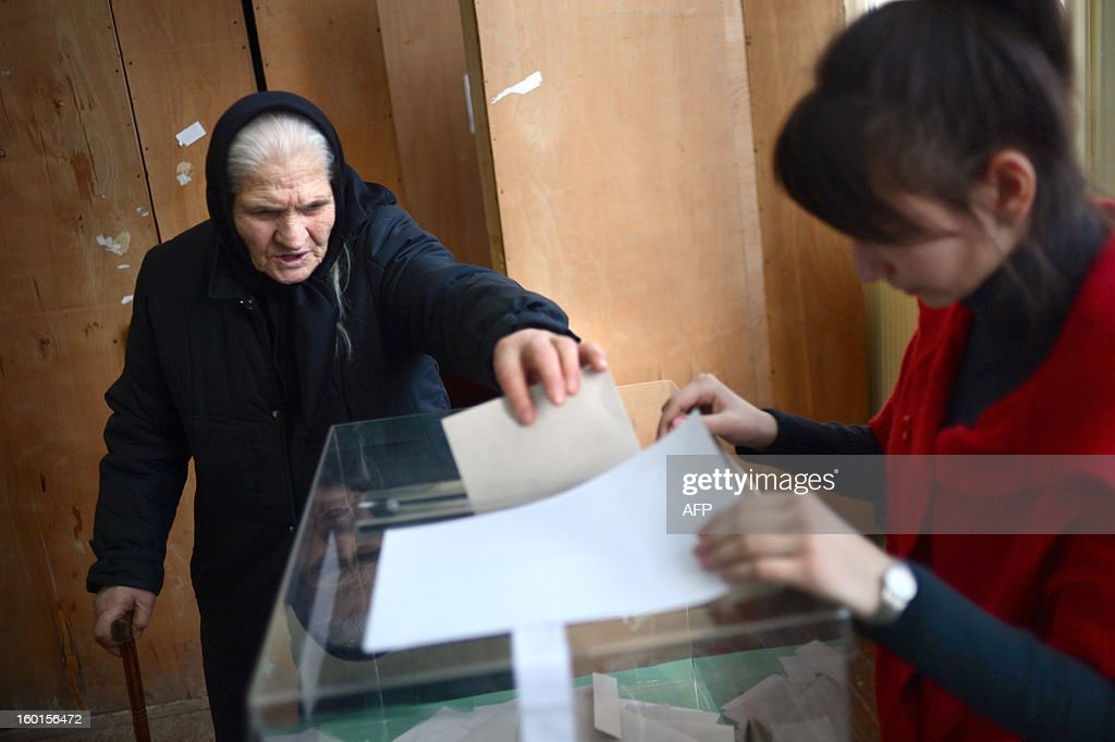 An elderly woman casts her ballot at a polling station during the national referendum in the town of Belene on January on 27, 2013. Bulgarians voted Sunday on whether to revive plans ditched by the government to construct a second nuclear power plant, in the EU member's first referendum since communism. The referendum asks 6.9 million eligible voters: 'Should Bulgaria develop nuclear energy by constructing a new nuclear power plant ?'. AFP PHOTO / DIMITAR DILKOFF