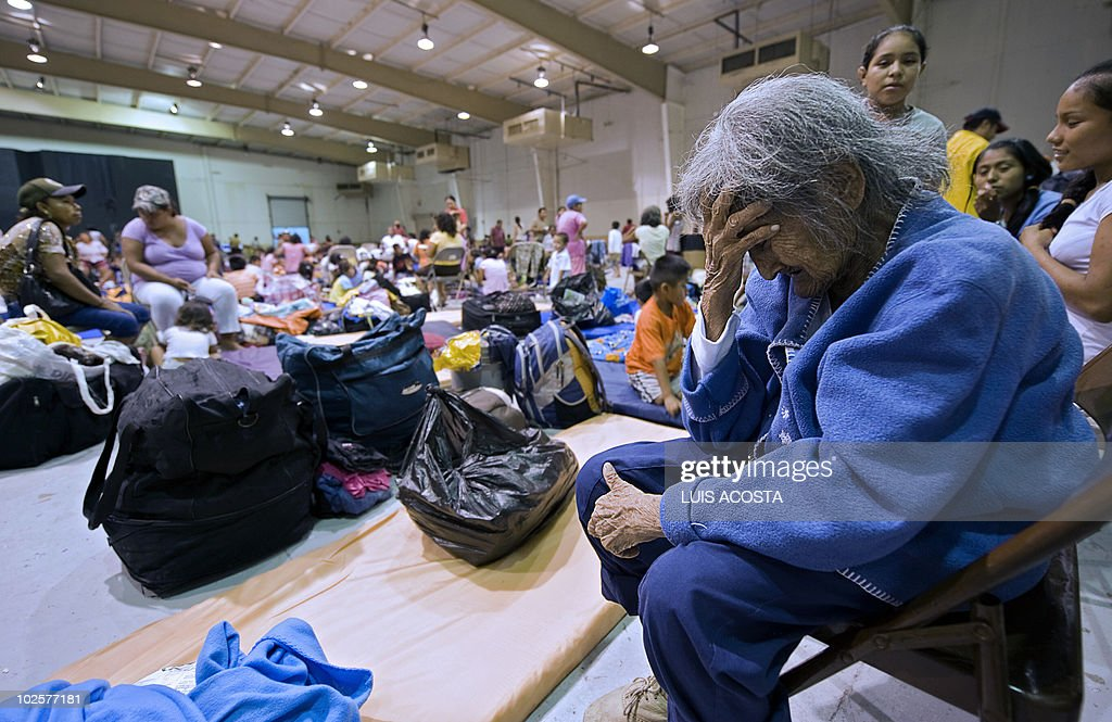 An elderly woman cries at a shelter in Matamoros, Tamaulipas state, Mexico on June 30, 2010. Hurricane Alex was set to make landfall late Wednesday or early Thursday south of the US border with Mexico, possibly as a Category Two hurricane, the Miami-based National Hurricane Center said. AFP PHOTO/Luis Acosta