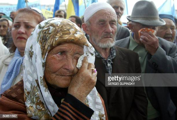 An elderly woman cries during a rally of Crimean Tartars in the center of Simferopol Crimea 18 May 2004 The rally marks the 60th anniversary of the...