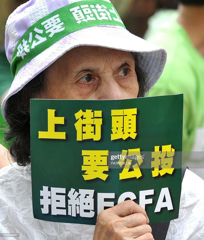 An elderly woman demonstrator holds a sign during a sit-in protest in Taipei on May 20, 2010. Hundreds of supporters of Taiwan's major pro-independence opposition rallied in the capital city as part of the party's efforts to stop the government from forging a trade pact with China. The sign reads: 'I want to decide my own future, ECFA must be decided through referendum.' ECFA stands for Economic Cooperation Framework Agreement, a contentious trade pact Taiwanese government plans to sign to sign with China.