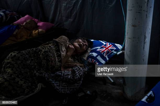 KLUNGKUNG BALI INDONESIA SEPTEMBER 25 An elderly woman got treatments in medical tent at evacuation center on September 25 2017 in Klungkung regency...