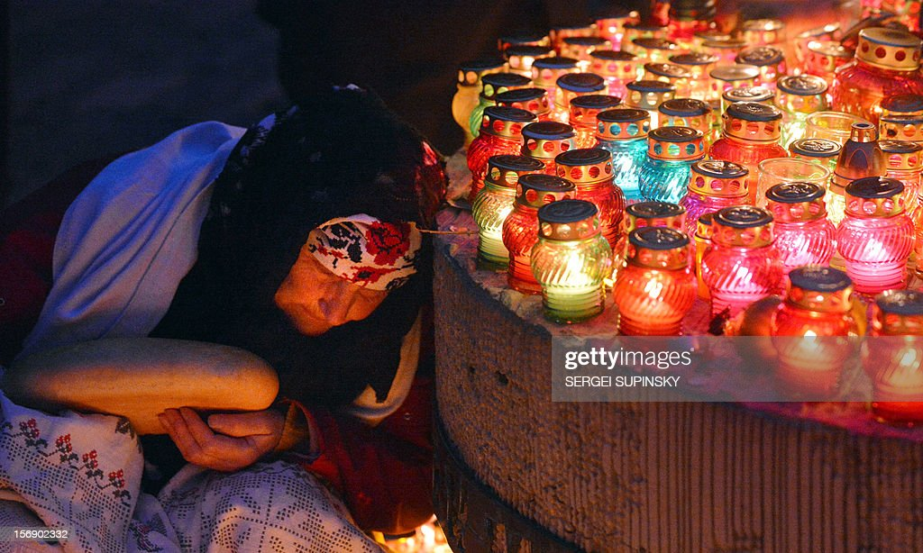 An elderly woman holds a bread loaf as candles were set up in memory of the victims of the Holodomor famine in Kiev on November 24, 2012. Ukraine marked 80 years since the Stalin-era Holodomor famine, one of the darkest pages in its entire history that left millions dead and which is regarded by many as a genocide. The 1932-33 famine took place as harvests dwindled and Josef Stalin's Soviet police enforced the brutal policy of collectivising agriculture by requisitioning grain and other foodstuffs.
