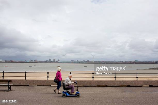An elderly woman in a mobility scooter on Marine Promenade in New Brighton In 1986 world famous photographer Martin Parr published his book 'The Last...