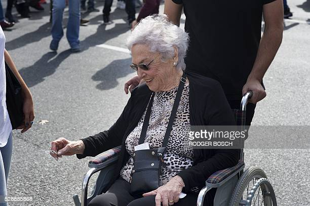 An elderly woman in a wheelchair joins thousands of people taking part in a march through the central city calling for the South African government...