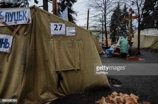 An elderly woman is seen praying Supporters of the former Georgian President Mikheil Saakashvili from different regions of Ukraine camp outside the...
