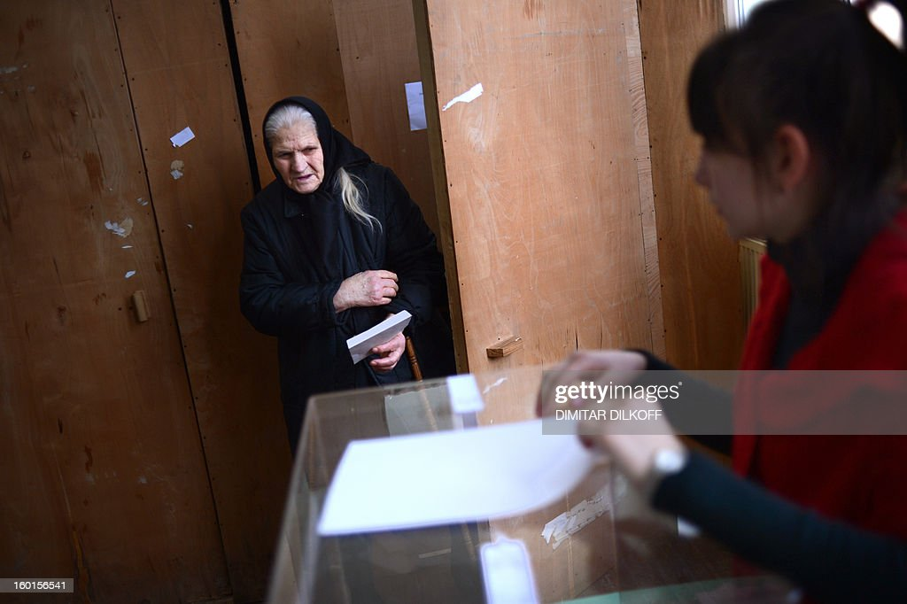 An elderly woman leaves a polling booth before voting during the national referendum in the town of Belene on January 27, 2013. Bulgarians voted Sunday on whether to revive plans ditched by the government to construct a second nuclear power plant, in the EU member's first referendum since communism. The referendum asks 6.9 million eligible voters: 'Should Bulgaria develop nuclear energy by constructing a new nuclear power plant?'