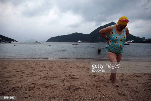An elderly woman leaves the water following a morning swim in Hong Kong on September 18 2011 Regardless of weather or water temperature the ritual of...